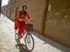 Woman in Red on Bike